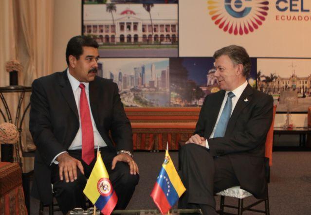 Los presidentes de Colombia, Juan Manuel Santos(I), y Venezuela, Nicolás Maduro(D), foto vía EFE