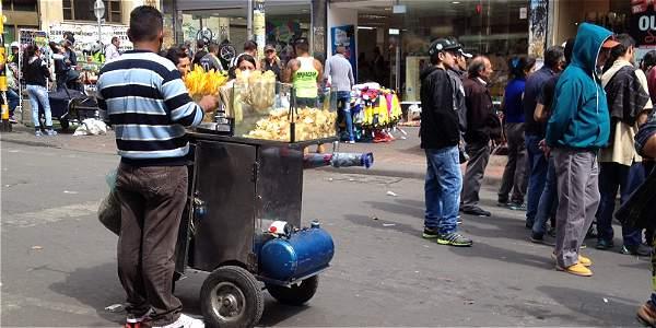 Vendedores, foto vía El Tiempo